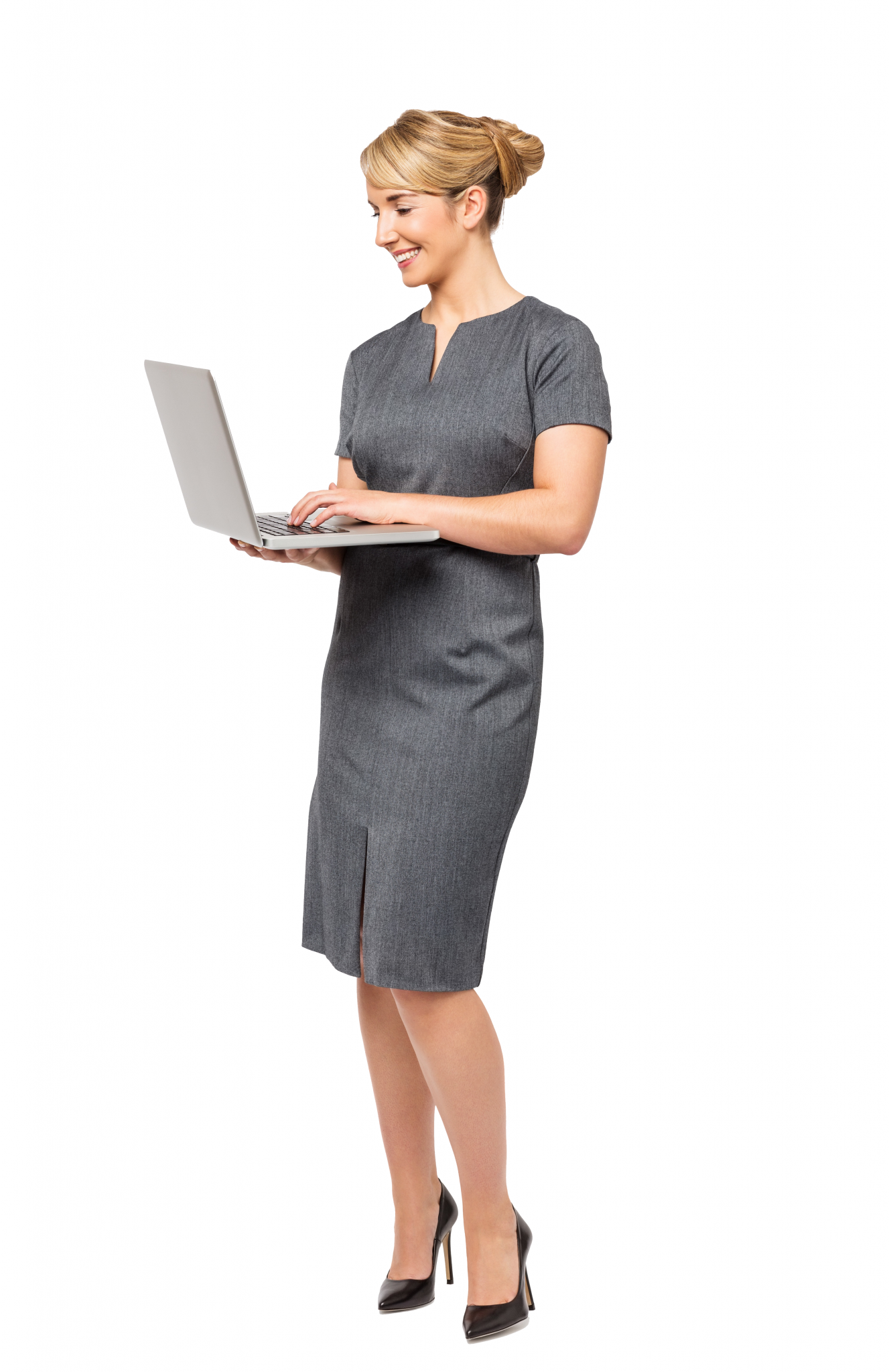 Woman standing working on computer